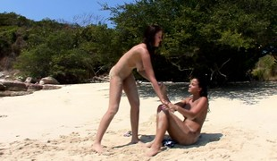 Buxom beauties taking care of eternally other's lesbian urges surpassing the beach