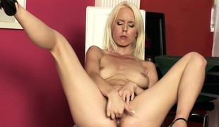Attracting blonde spreads her legs be required of her fingers increased by a purple dildo