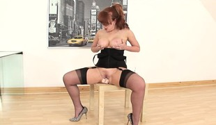 Plump redhead in disastrous lingerie works the brush aching squeak above a big dildo