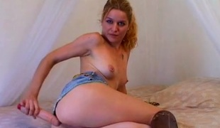 Cam girl in sexy leather boots fucks a dildo
