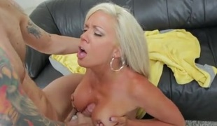 Mommy with a pair of fake gut sucks a dick