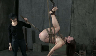 Lustful woman fucks cunt of destined up sex slave in suspended position